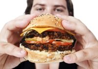 man with unhealthy burger